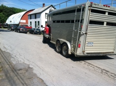Trailer pulls into auction house lot.